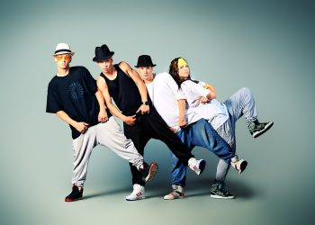 Group of modern dancers dancing hip-hop at studio.