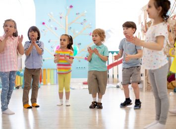 preschool kids group have fun playing at kindergarden